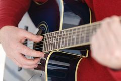 Detail of a guitarist playing a classical guitar Stock Images