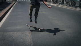 Detail of a guy performing a trick while skateboarding Royalty Free Stock Image