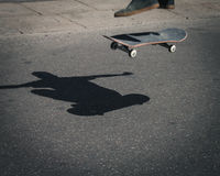 Detail of a guy performing a trick while skateboarding Royalty Free Stock Images