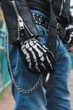 Detail of a guy wearing skeleton gloves Royalty Free Stock Image
