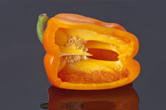 Detail of half slice of yellow pepper. Yellow bell pepper sliced open to reveal the seeds inside stock images