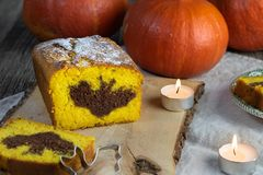 Detail on a Halloween Pumpkin cake with a cocoa bat symbol on the cut royalty free stock images