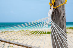 Detail of hammock tie on a tropical beach Stock Photography