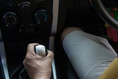 Detail of Hand in gear shift. Drive transmission stock photo