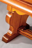 Detail of hand made wooden bench. Detail shot of an end of a hand made wooden bench Royalty Free Stock Photo