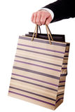 Detail of a hand of a man doing shopping,with bags Stock Images