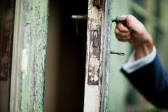 Detail on hand - opening vintage doors royalty free stock photography