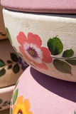 Detail of hand painted pottery. Hand painted pottery with floral and leaf designs Royalty Free Stock Photos