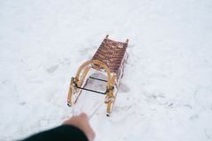 Hand pulling sled Royalty Free Stock Image