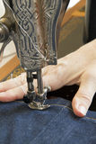 Detail of hand and sewing mashine Stock Images