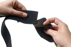 Detail hand and velcro. On white background royalty free stock photo