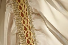 Embroidery and silk fabric royalty free stock photo