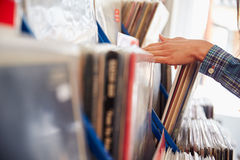 Detail of hands browsing records at a record shop Royalty Free Stock Photo