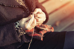 Detail of the hands of an elderly person crocheting Stock Image
