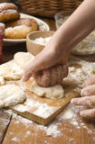 Detail of hands kneading dough Royalty Free Stock Images