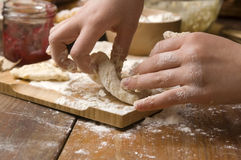 Detail of hands kneading dough Stock Images