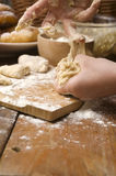 Detail of hands kneading dough Stock Photography