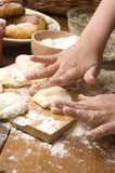 Detail of hands kneading dough Stock Photos
