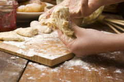Detail of hands kneading dough Royalty Free Stock Photo