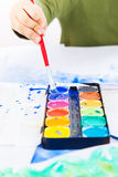 Detail of hands painting Royalty Free Stock Images