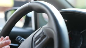 Detail of hands turning steering wheel. Detail of hands turning steering wheel in car stock footage