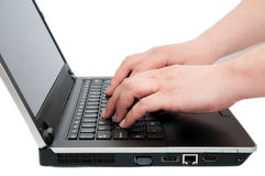 Detail of hands typing on  a notebook Stock Photos