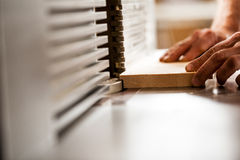 Detail of the hands of a woodworker Royalty Free Stock Image