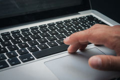 Detail of hands working on computer keyboard Royalty Free Stock Images