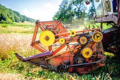 Detail of harvester machinery, tractor at farm Royalty Free Stock Photo
