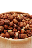 Detail of hazelnuts in wooden dish Stock Photography