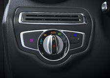 Detail of the headlight button in a car. Royalty Free Stock Photos
