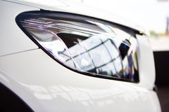 Detail on the headlight of car Stock Images