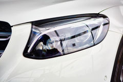 Detail on the headlight of car Stock Photography