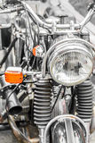 Detail on the headlight of a classic motorcycle. Big bike with h Stock Photo