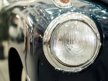 Detail on the headlight of a vintage car Stock Photography