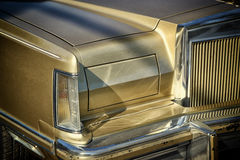 Detail on the headlight of a vintage car. retro style photo Royalty Free Stock Image