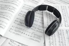Detail of headphones and piano score Stock Images