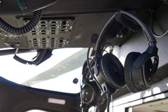 Close Up Of Headsets In Helicopter Cockpit. Detail Of Headsets In Helicopter Cockpit Royalty Free Stock Photography