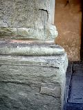 Detail of Heavily Eroded Marble Column, Florence, Italy. Detail of the base of a badly eroded, weathered and rough textured ancient marble column, Florence Royalty Free Stock Images