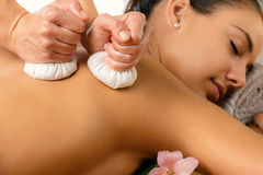 Detail of herbal pinda massage. Royalty Free Stock Images