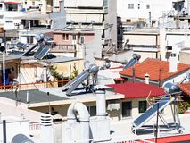 Solar Hot water Systems on High Density Athens Houses, Greece. Detail of high density Athens houses, many having solar hot water systems mounted on roof tops stock photo