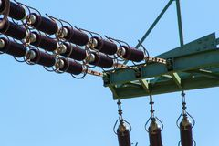 Detail of high-voltage ceramic insulator. High Voltage Lead.  Electricity distribution. Stock Photos