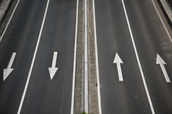 Detail in a highway,with four arrows. Stock Photos