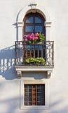 Detail of a historic building`s facade. Flowered balcony and windows on a historic building`s facade Stock Photo