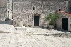 Detail of historic, stone built mediterranean city. St Chrysogonus' Church in Šibenik - small Romanesque styled church built in 12th century royalty free stock photography