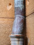 Old Copper Drain Pipe on Sandstone Building. Detail of an historic Sydney, NSW, Australia, sandstone building, with a patinated and tarnished copper storm water stock images
