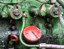 Detail of a historic tractor old-timer motor. Detail of an old historic tractor old-timer motor Stock Photos