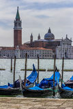Detail of a Historical Building in Venice with Gondolas in the F Stock Images
