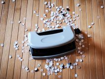 Hole puncher with paper confetti. Detail of hole puncher with paper confetti Stock Photos