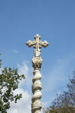 Detail of a holy cross carved in stone Royalty Free Stock Image